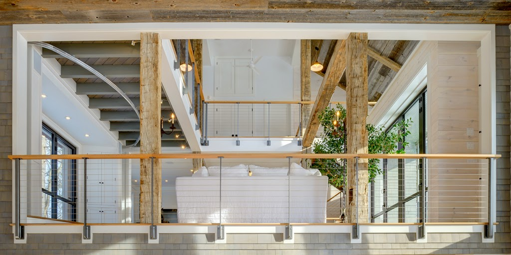 Ithaca style cable railing show on multiple interior levels of a party barn.