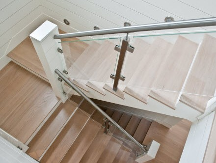 Glass stair railing and stainless steel hand rail