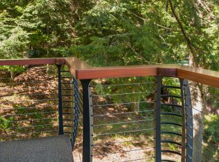 Keuka curved cable railing with wood top rail