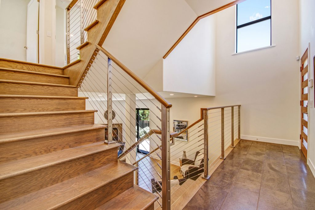 Ithaca style interior stainless steel cable railing on staircase