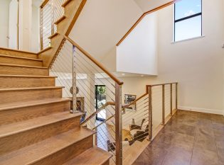Ithaca style stainless steel cable railing on switch back stair