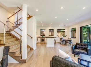 Living room and kitchen with staircase