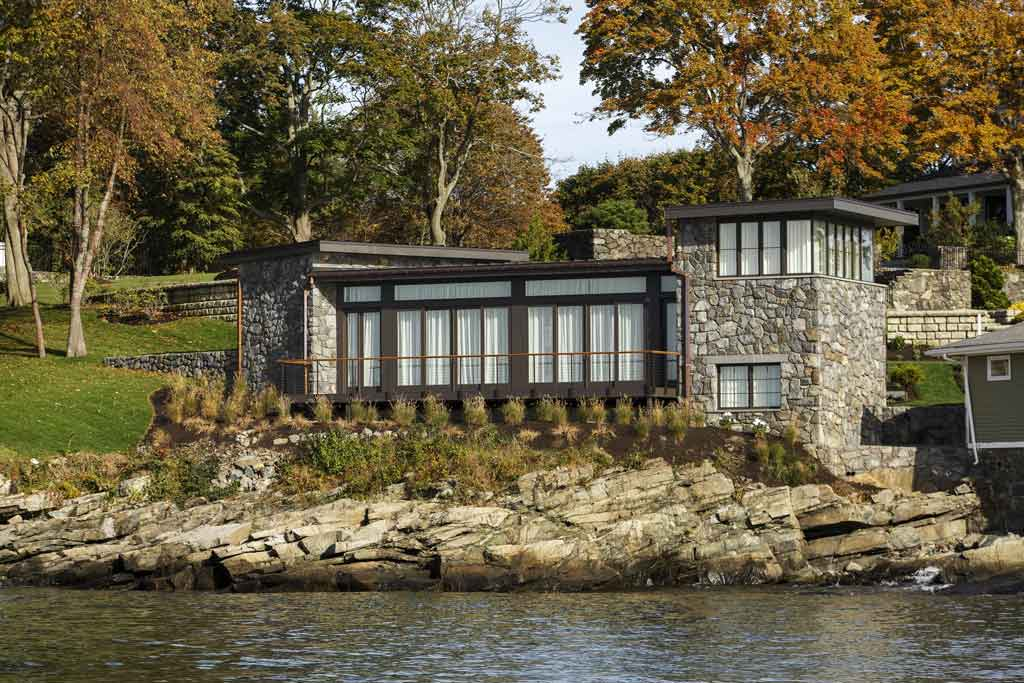 Stone home with steel and glass