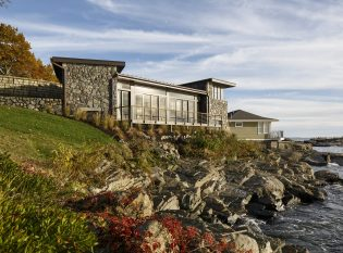 Cliff Side Stone Home with Keuka cable railing