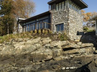 Stone house with Keuka railing