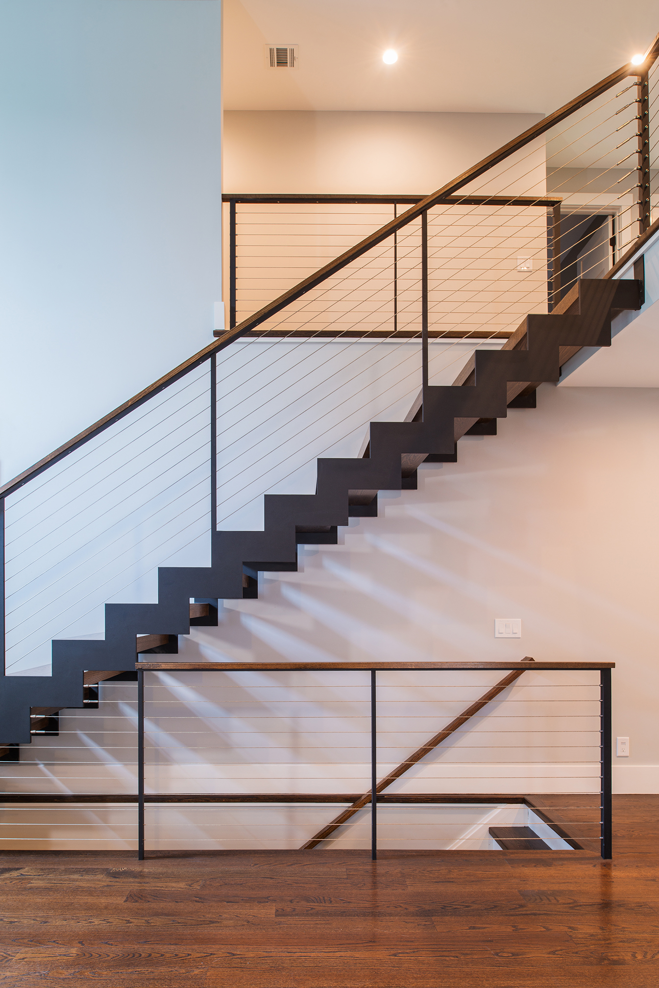 Floating staircase with zig zag stair stringers