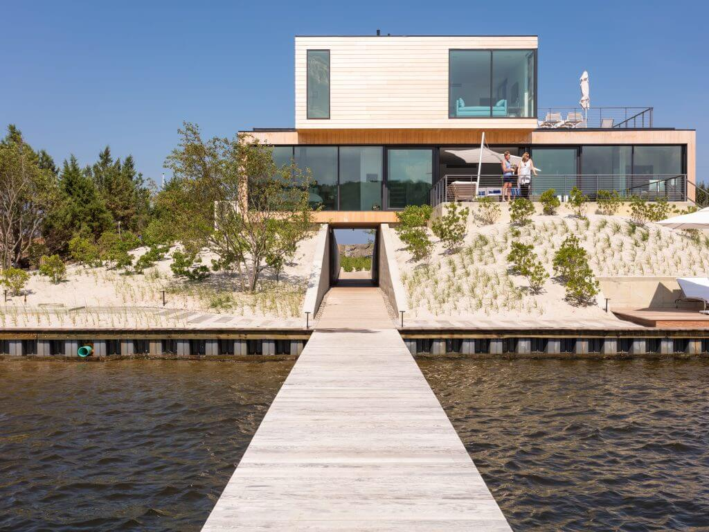 Hurricane resistant home built 15 ft above sea level to allow for a storm surge canal.