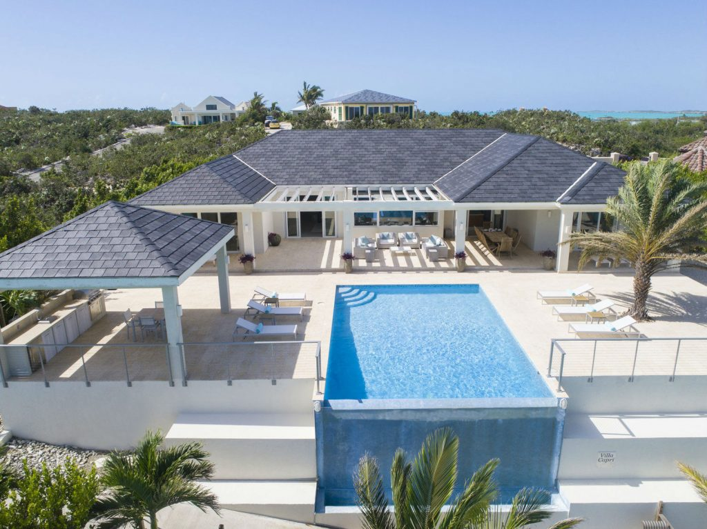 Infinity edge pool with Keuka studios Ithaca style railing on a beautiful villa in the Turks and 0caicos.
