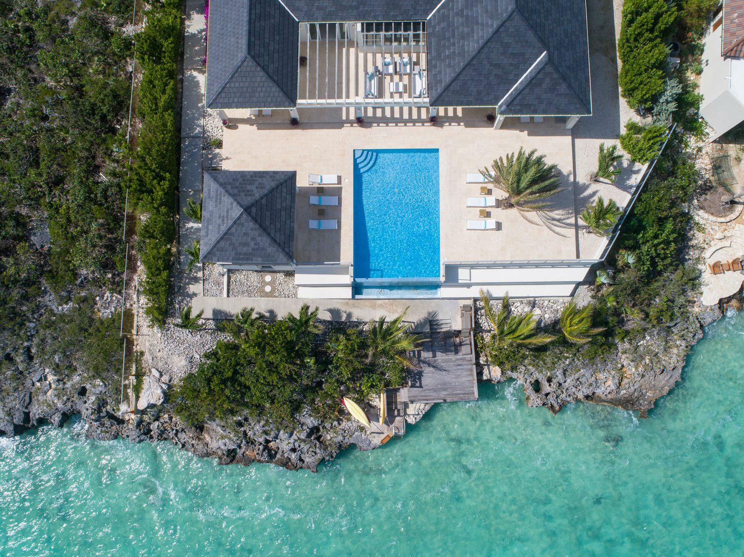 Aerial view of Villa Capri with infinity edge pool and beach