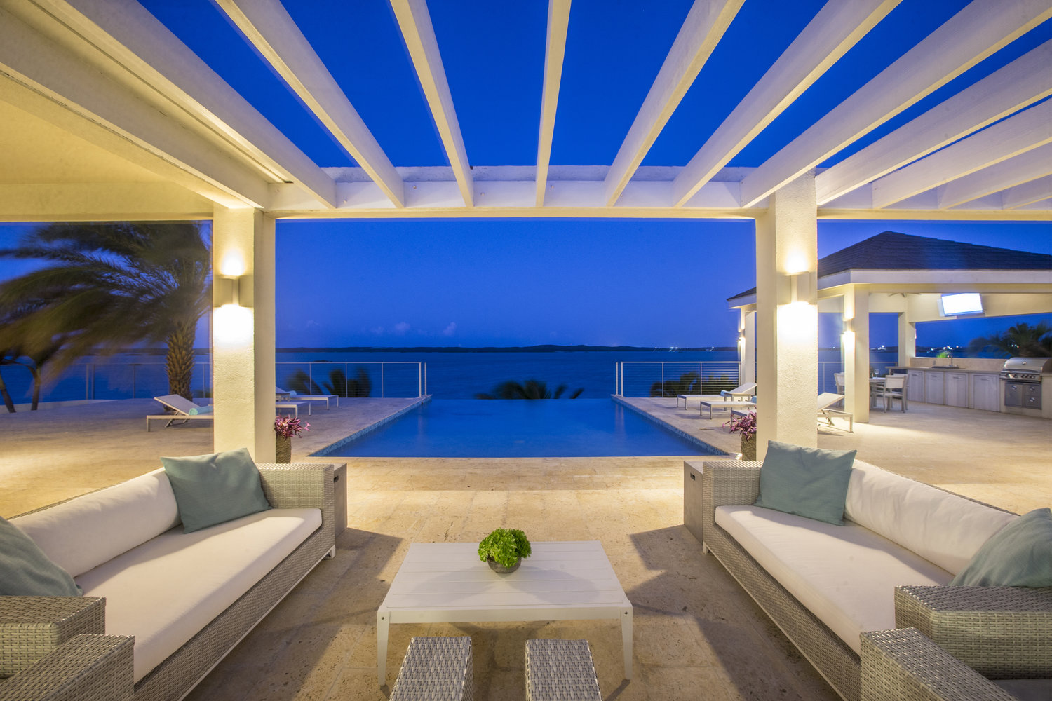 Pergola with night lighting and infinity edge pool