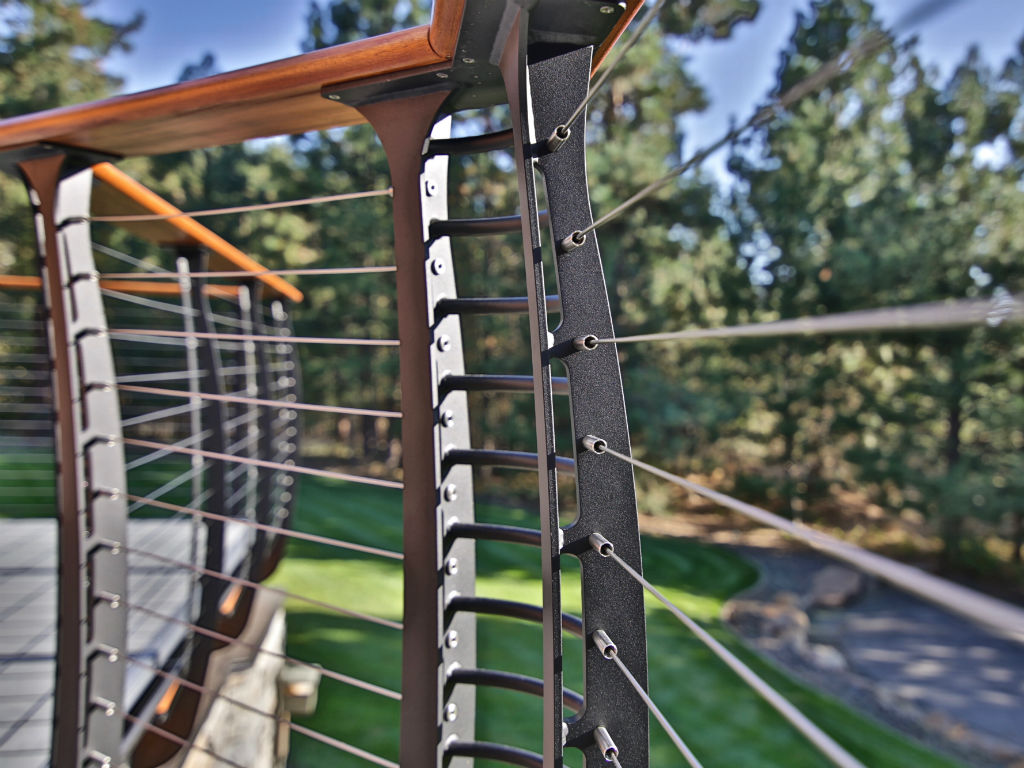 Close up of curved deck railing by Keuka Studios