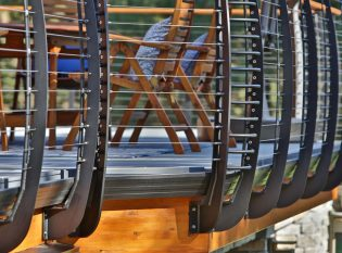 Custom made curved deck railing fascia mounted