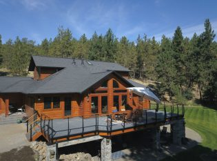 Log home with curved deck railing