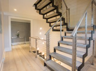 Zig Zag stringers on floating modern staircase with wood treads