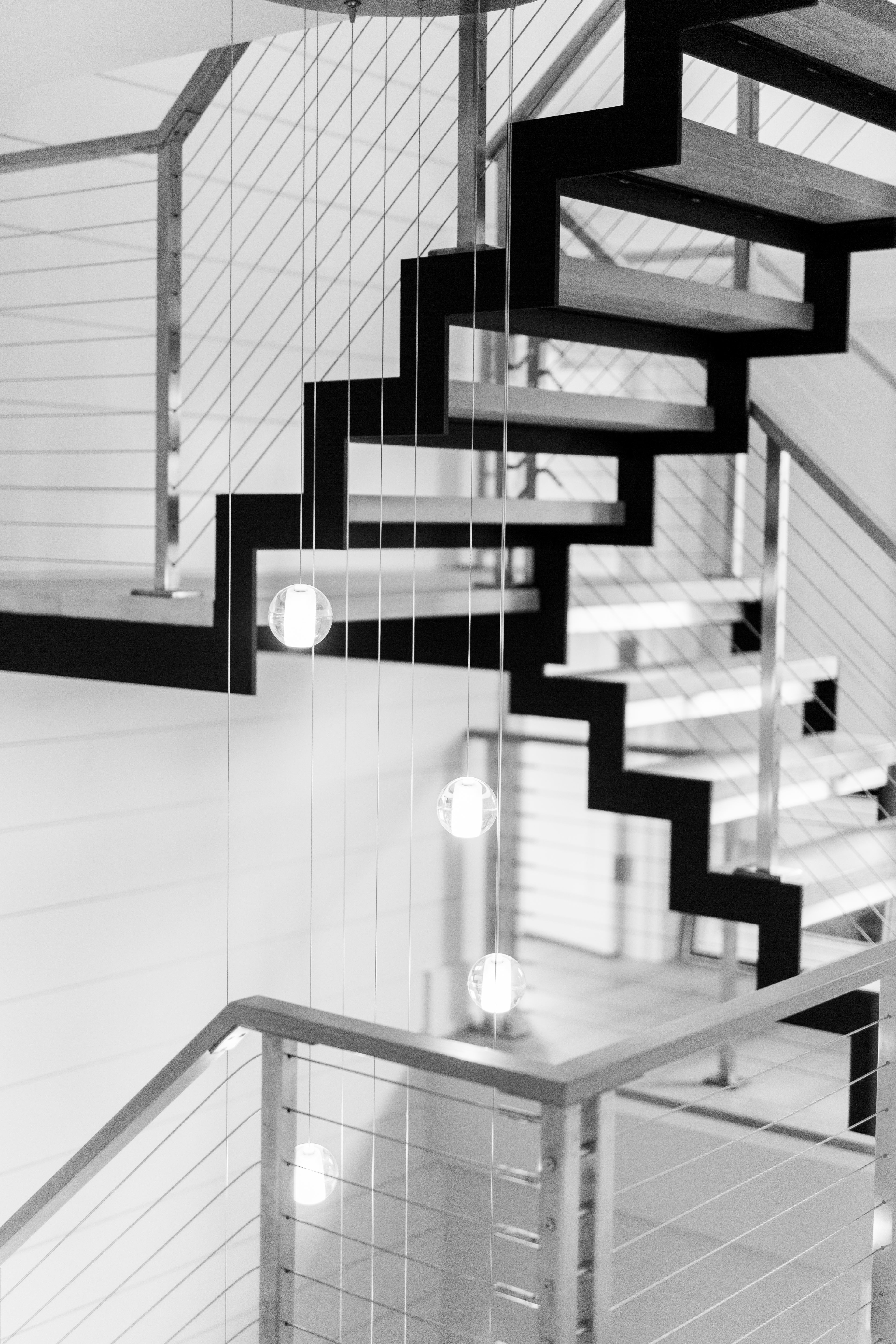 Modern Staircase combines stainless steel and oak