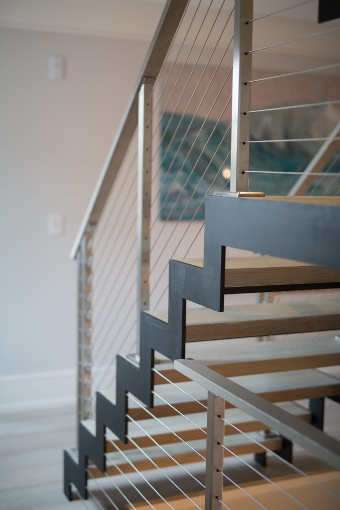Greenwich modern staircase with zigzag stringer and cable railing