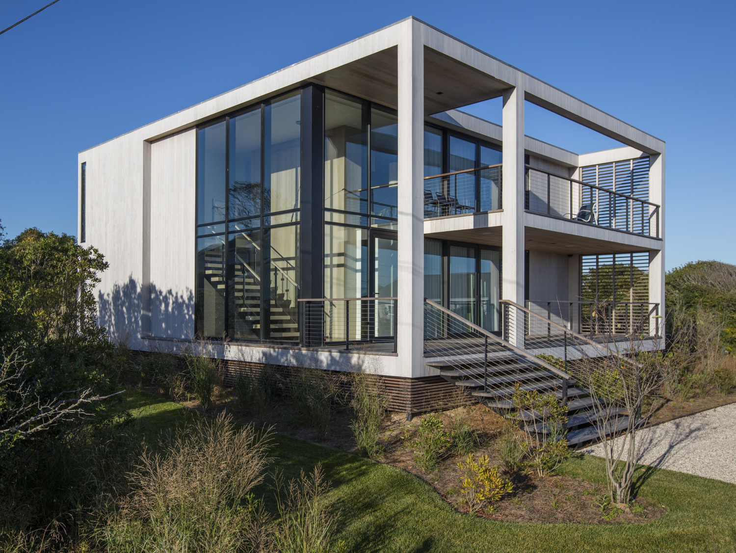 Floor to ceiling glass on a modern cube home in Montauk, NY