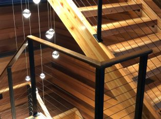 Interior rustic wood staircase with cable railing system