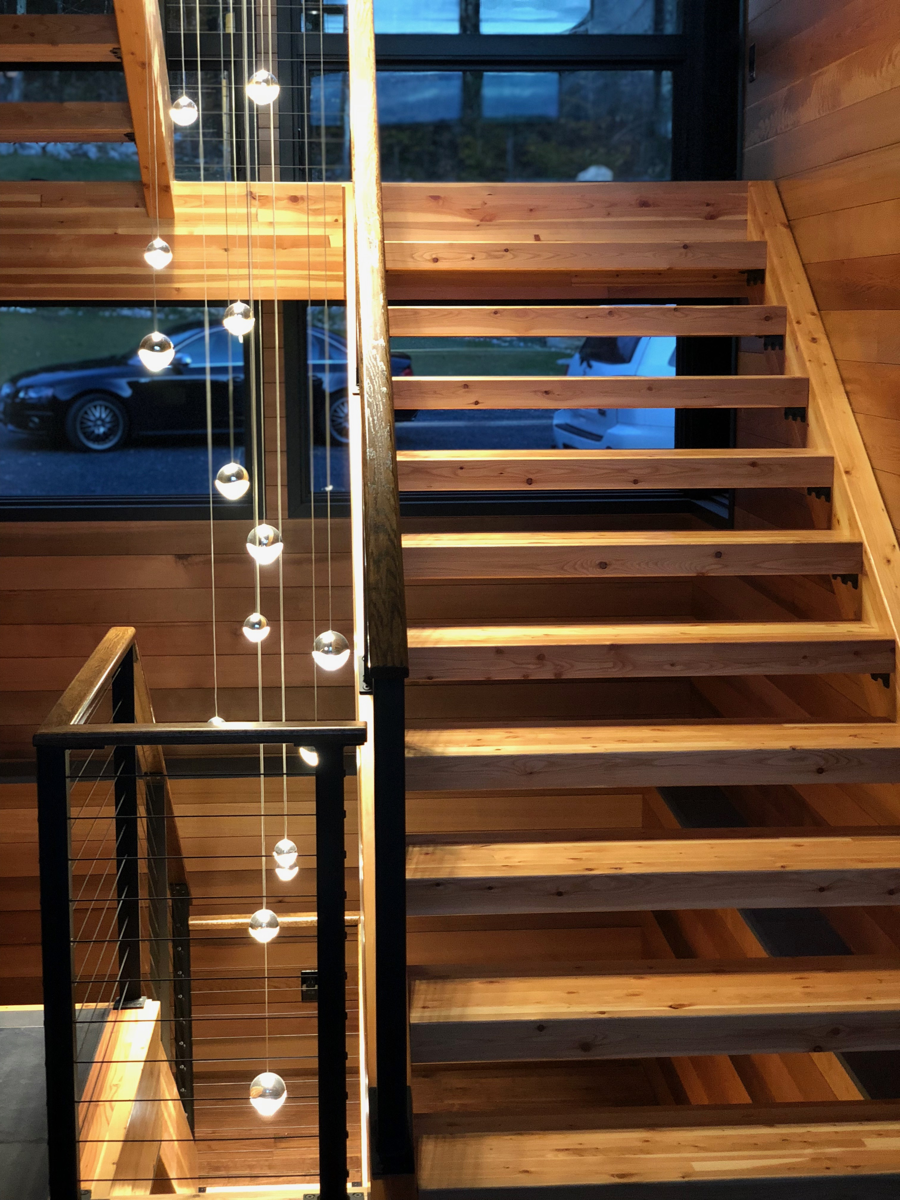 Wood treads on rustic stairs with modern lighting