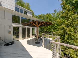 Upper level deck with modern railing system