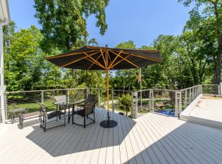 Outdoor dining with Keuka Studios Chicago style railing