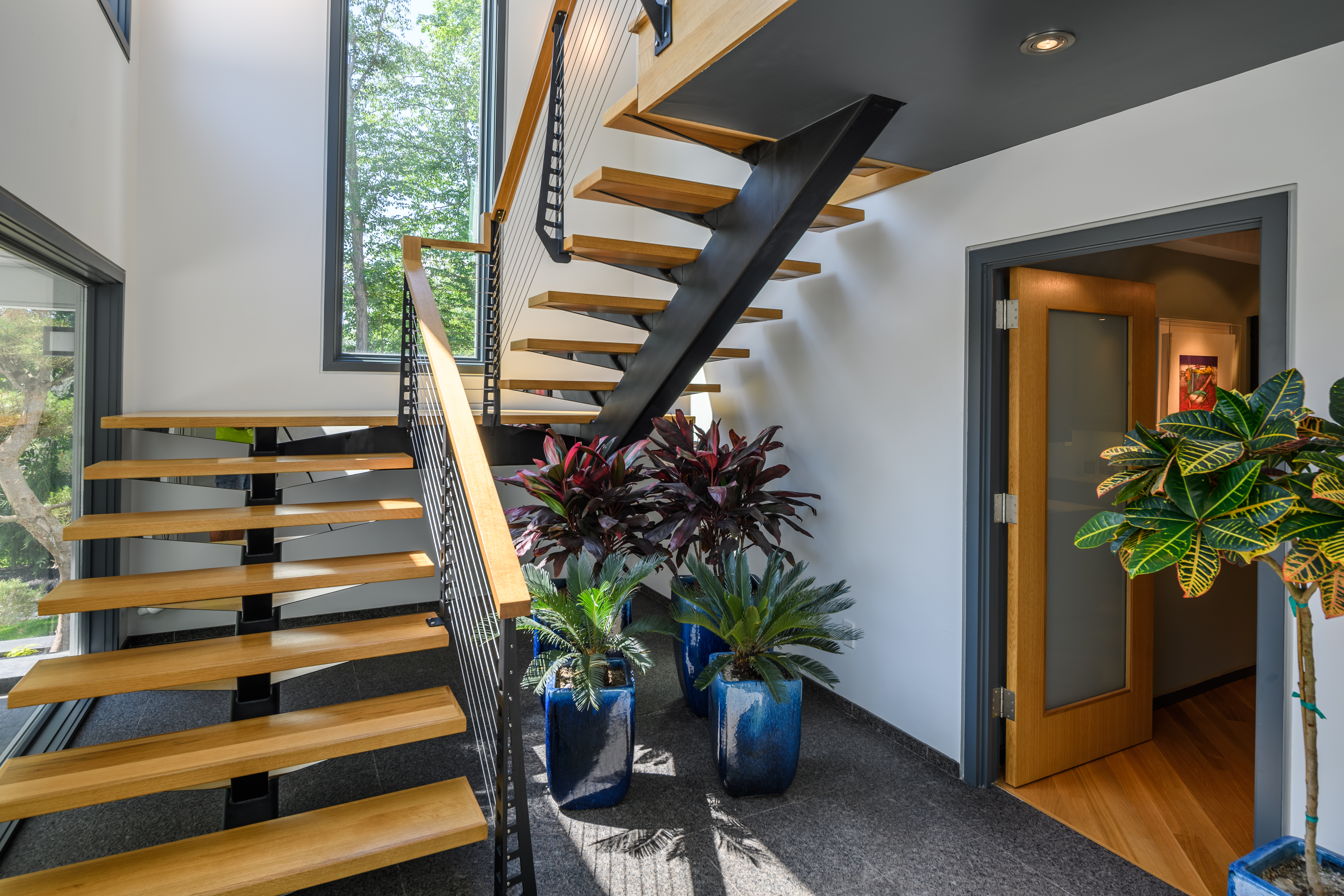 Custom mono-stringer steel stair with wood treads.