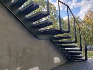 Cantilevered stairs by Keuka Studios