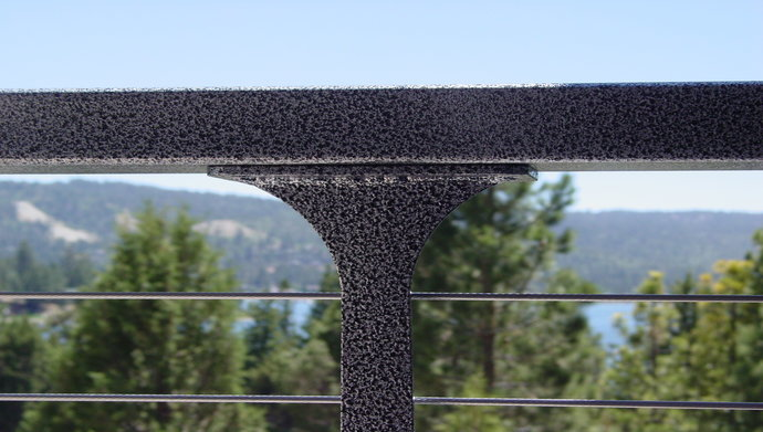 Close up of silver powder-coated post and aluminum top rail