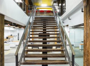 Bare Steel Mono-Stringer Staircase and Cable Railing