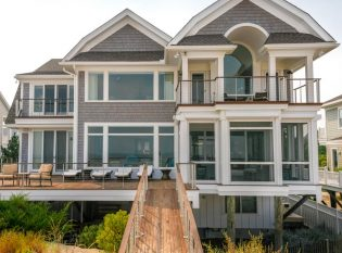 Beach house with cable railing system.