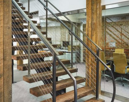 Commercial floating stairs with clear matte coated steel