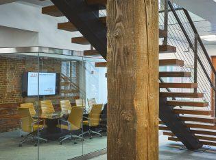 Underside of mono-stringer natural steel staircase.
