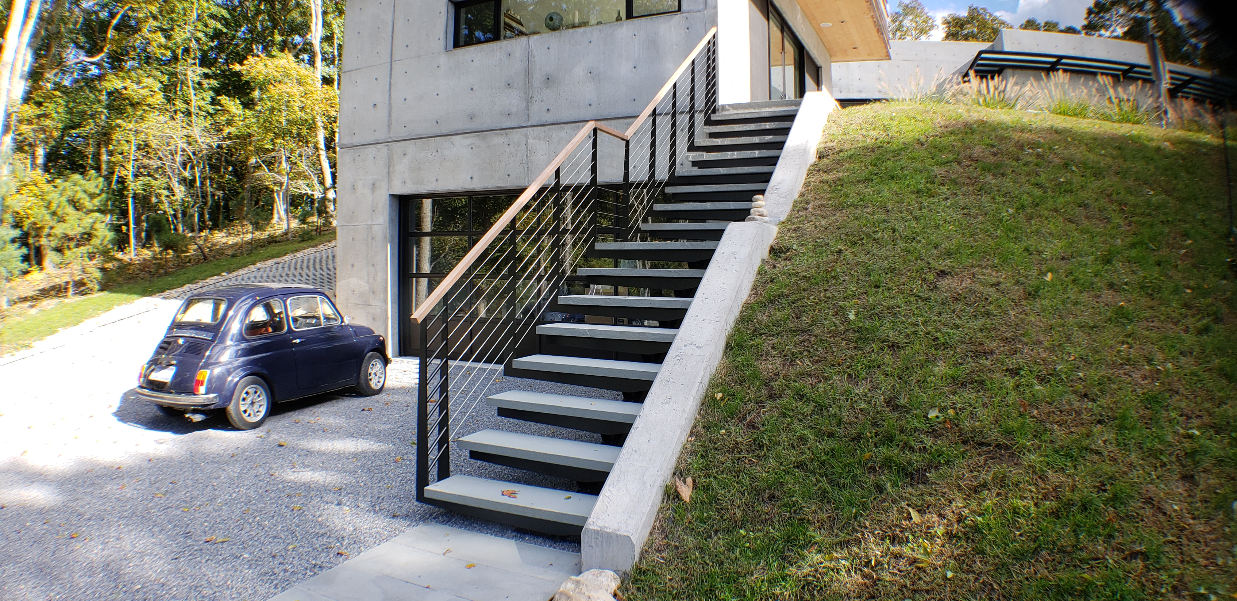 Exterior mono stringer stairs with stone steps