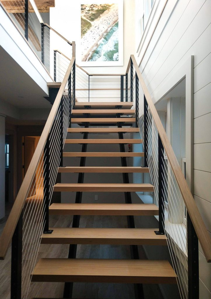 Contemporary staircase with cable railing for Nantucket home