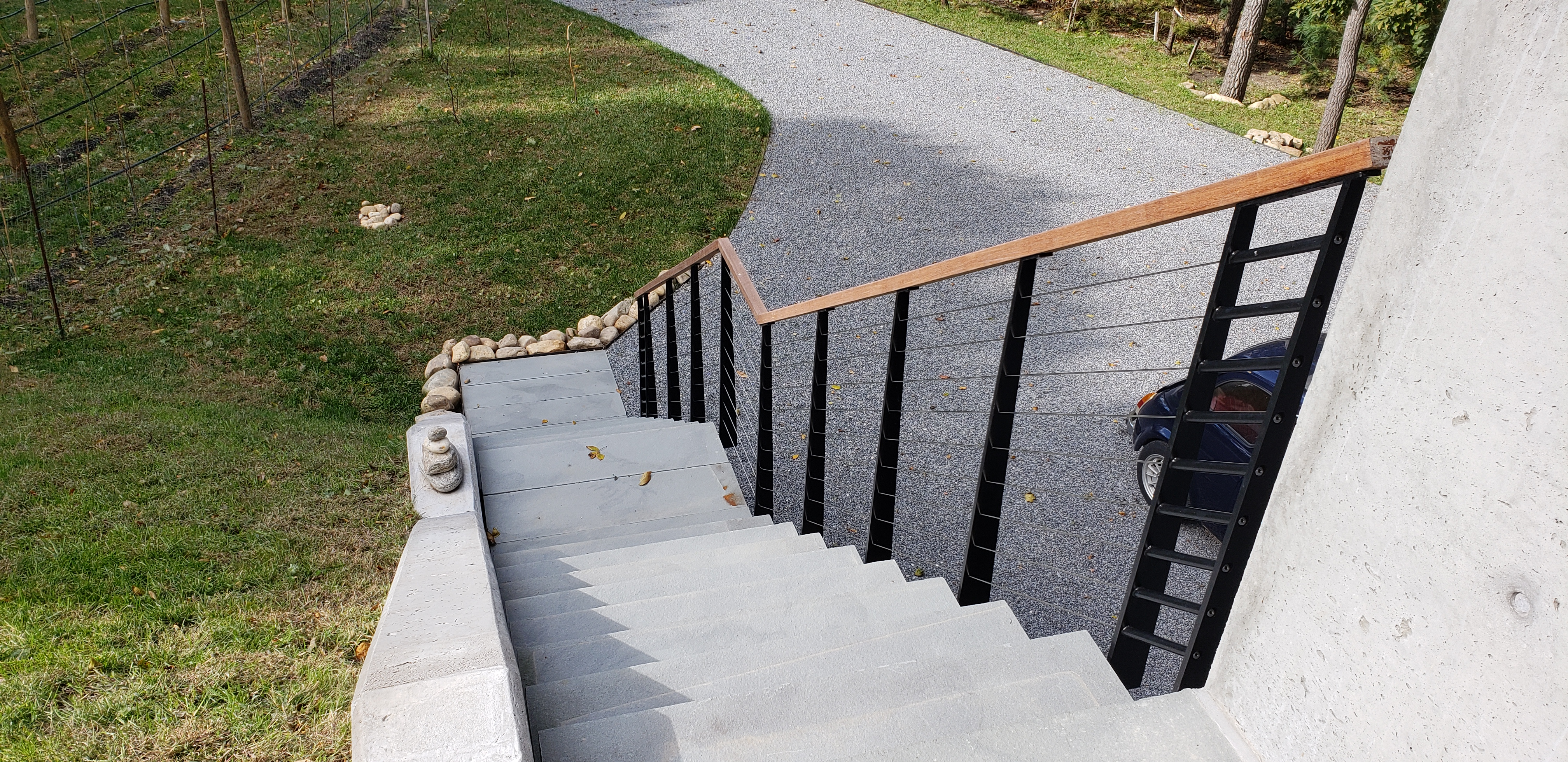 Mono stringer stairs with custom cable railing and stone steps