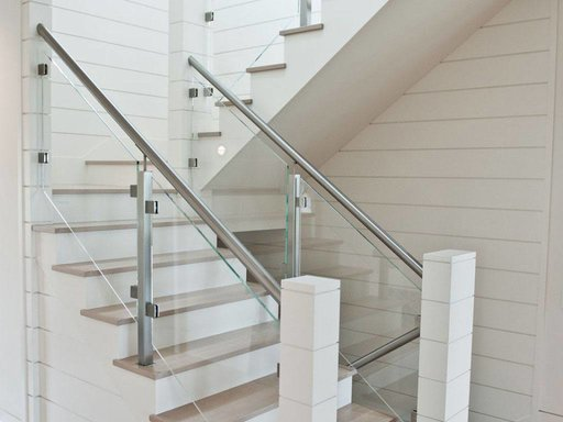 Glass railing with custom stainless steel posts and glass infill