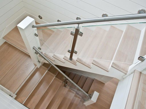 Modern multi-tier staircase with glass railing
