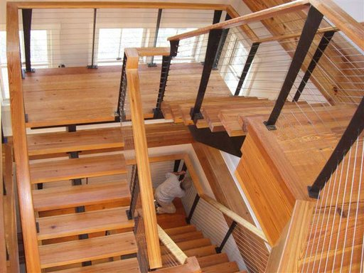 Custom staircase and railing in traditional Nantucket home