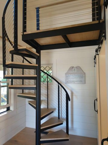 Custom spiral staircase with cable railing