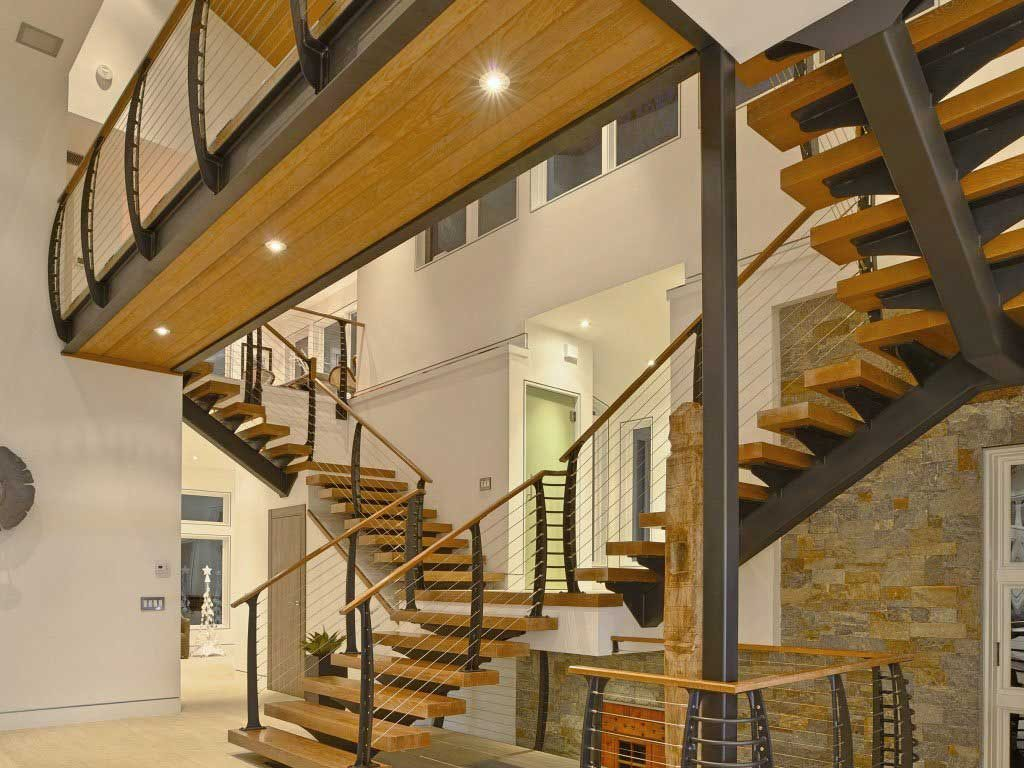 Double floating winder stair with catwalk and curved cable railing system.