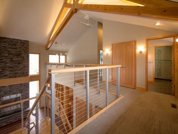 Exposed beam home in Rochester with anodized aluminum cable railing system