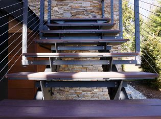 Floating staircase with composite lumber treads