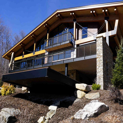 Exterior of Vermont mountain home with cable railing on deck and balcony