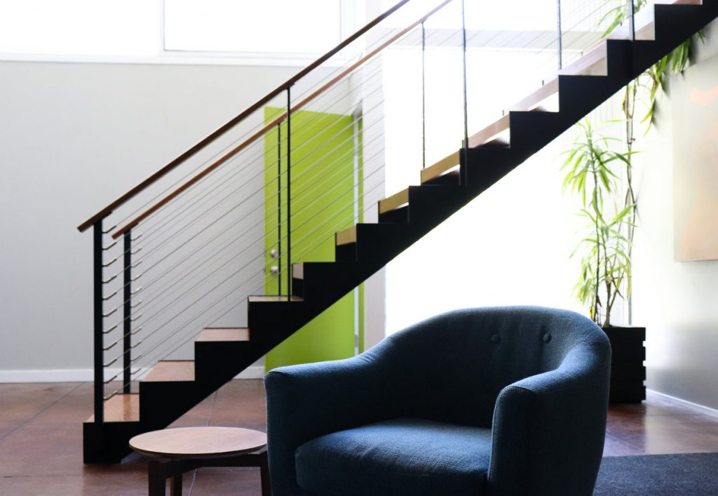 Mid-century modern furniture and floating staircase