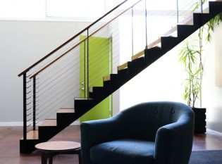Floating staircase and mid-century modern furniture