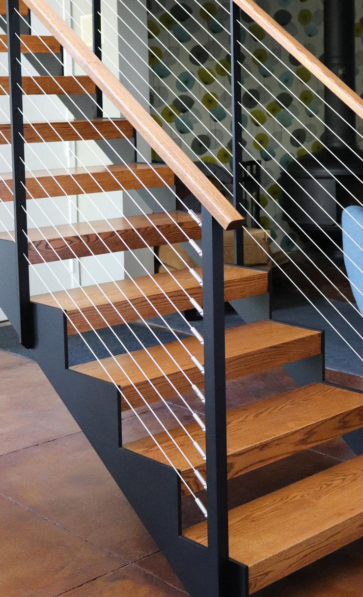 Black railing posts and wood top rail