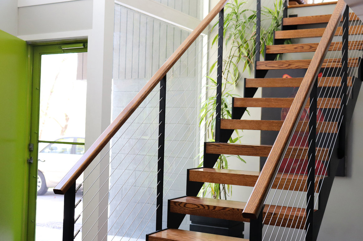 Steel sawtooth double-stinger staircase with wood treads