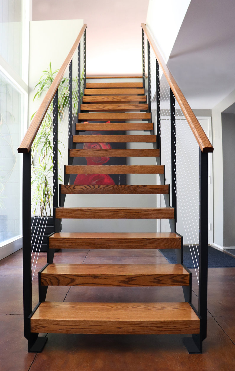 Interior sawtooth floating staircase and Ithaca Style railing