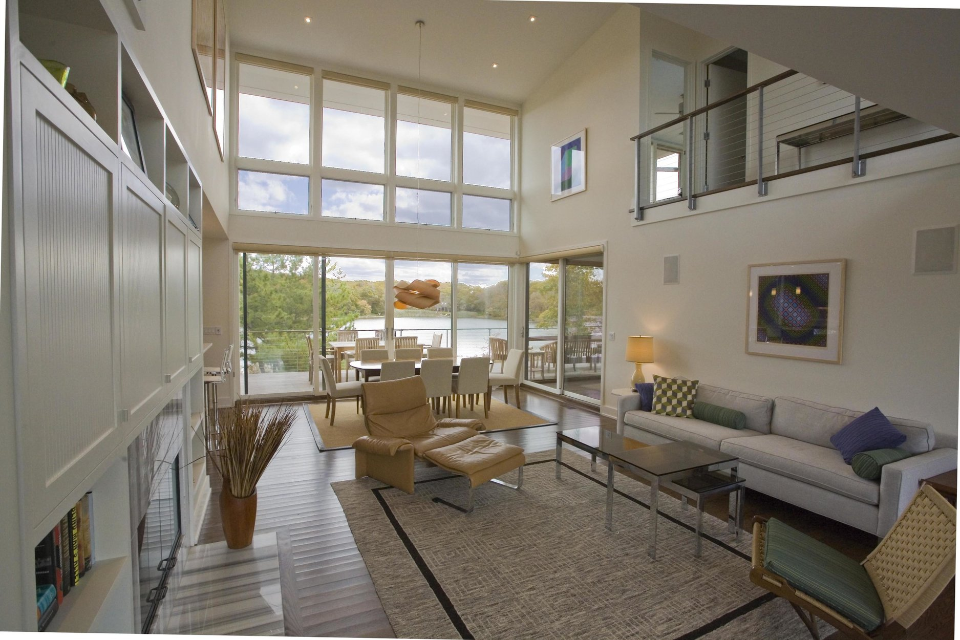 Living room with Ithaca Style cable railing balcony.
