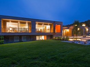 Contemporary Martha's Vineyard home at dusk.